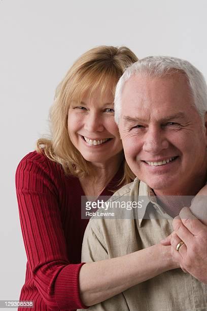 Portrait of elderly couple, studio shot