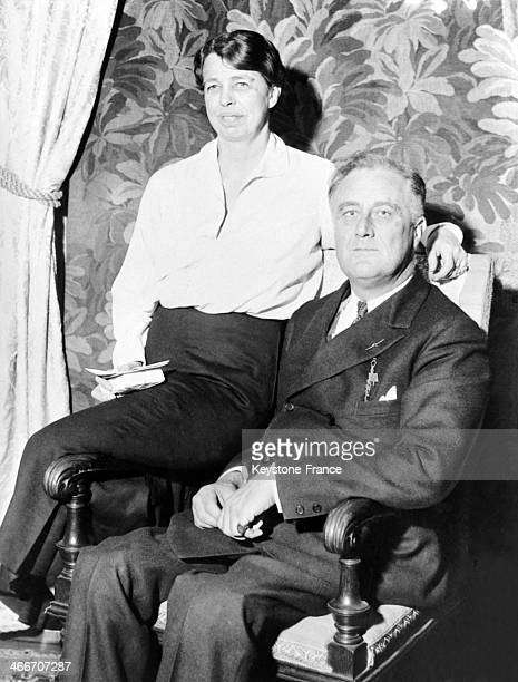 Portrait of Eleanor and Franklin D Roosevelt sitting on a chair in their house of Hyde Park in New York City in April 1933