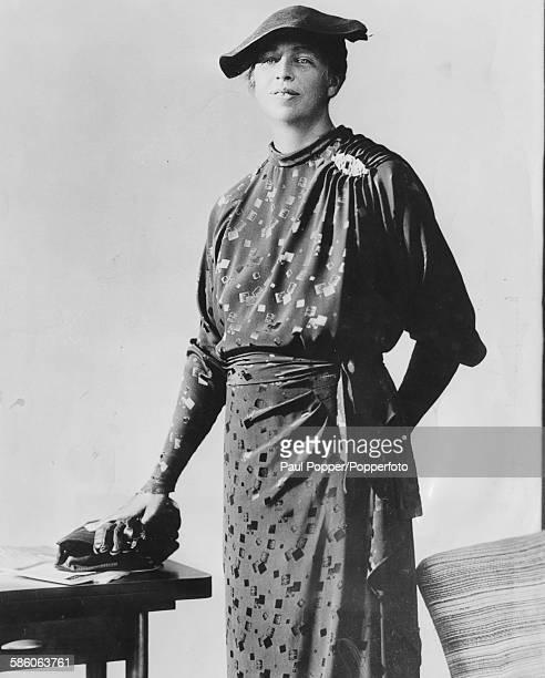 Portrait of Eleanor Roosevelt wife of President Franklin D Roosevelt modeling a patterned dress and hat circa 1935