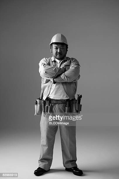 Portrait of electrician, with arms folded