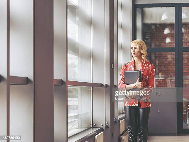 Portrait of elegance young woman, fashion designer in an office