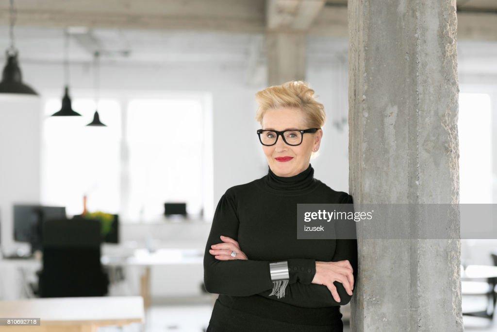 Portrait of elegant senior businesswoman in the modern studio : Stock Photo