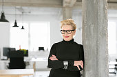 Portrait of elegant senior businesswoman in the modern studio