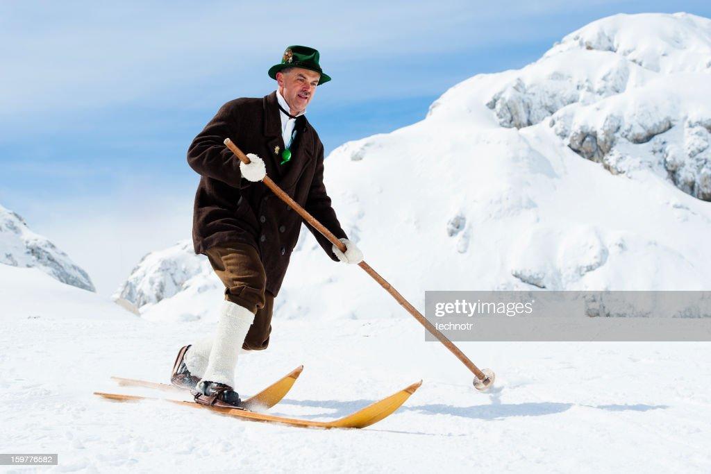 Portrait of elegant vintage skier in the mountains : Stock Photo