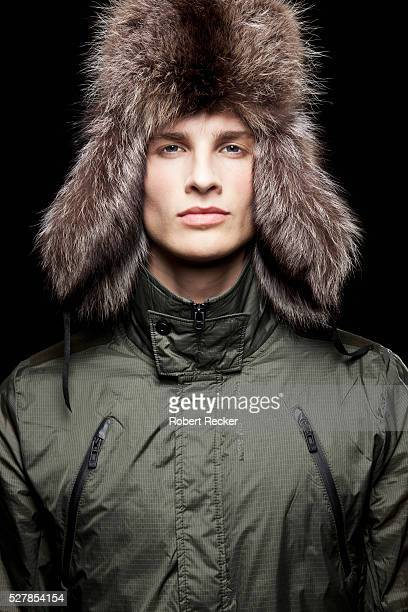 Portrait of elegant young man in winter outfit