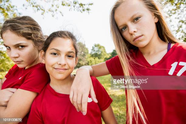 portrait of elementary aged soccer players - girl power stock pictures, royalty-free photos & images