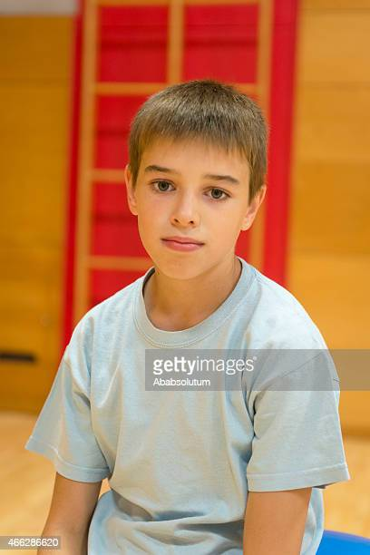 Portrait of Eleven Years Old Boy in School Gymnasium
