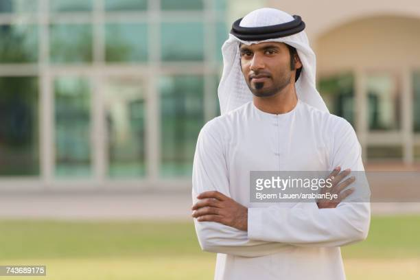 Portrait of Emirati man with arms crossed.