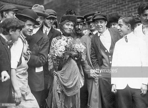 Portrait of Emmeline Pankhurst English woman suffragist She is shown standing with a group of men Undated photograph