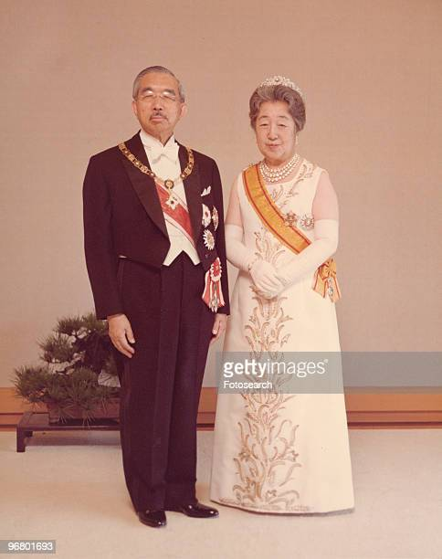 Portrait of Emperor Hirohito and wife Empress Kojun in formal attire circa 1950s