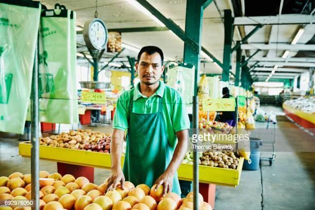Portrait of employee working in produce market