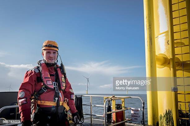 Portrait of engineer at sea at offshore wind farm