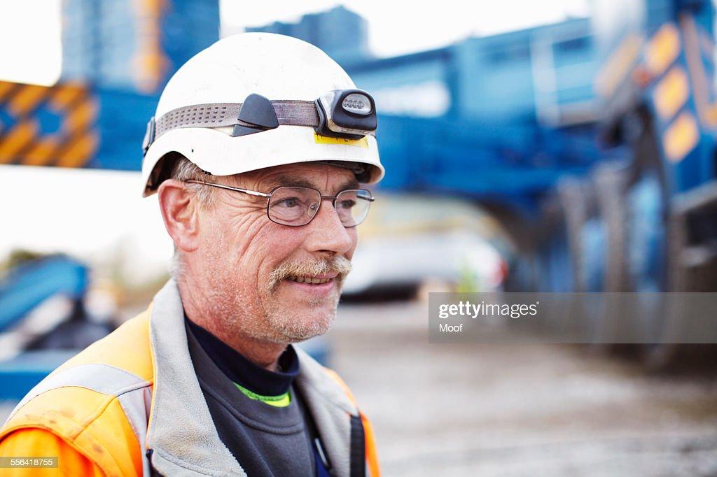 Portrait of engineer at wind farm : Stock Photo