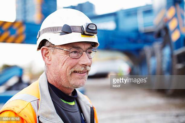 Portrait of engineer at wind farm