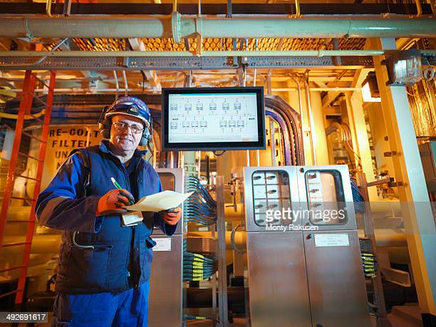 Portrait of engineer with digital display in power station