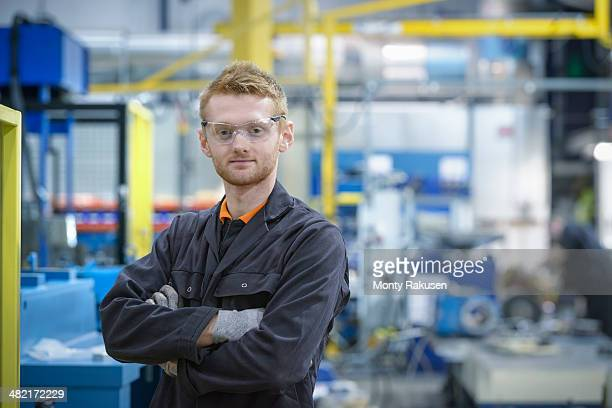 Portrait of engineering apprentice in engineering factory