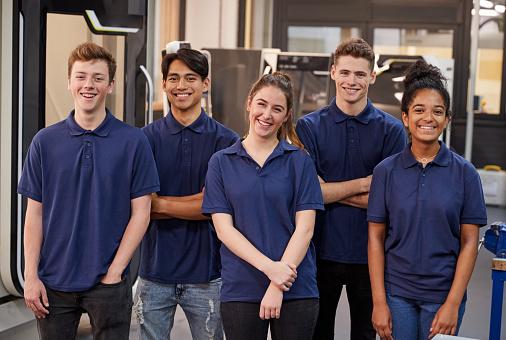 Portrait Of Engineering Apprentices In Factory 875673894