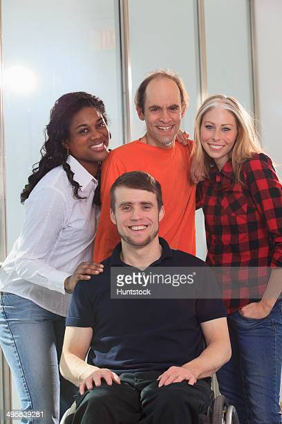 portrait of engineering students, one man with spinal cord injury in wheelchair and other one with aspergers - autism spectrum disorder stock photos and pictures