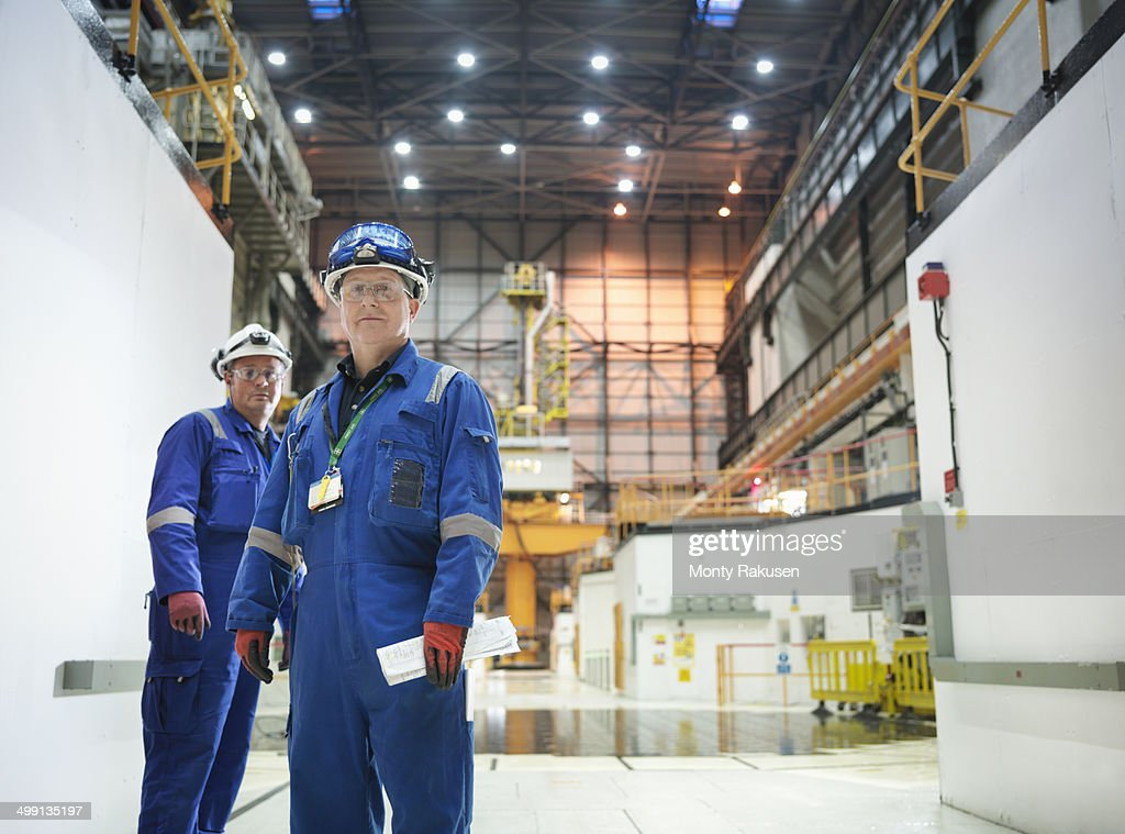Portrait of engineers in reactor hall in nuclear power station : Stock Photo