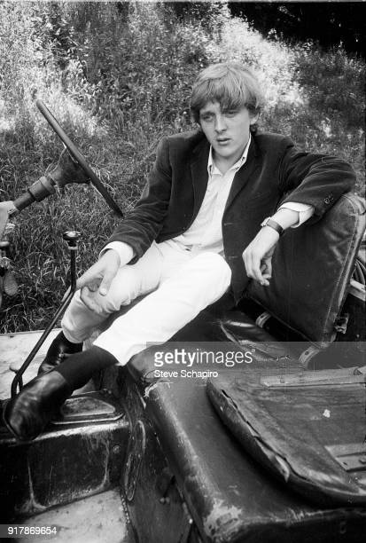 Portrait of English actor David Hemmings as he sits in a Land Rover on the set of the film 'BlowUp' London England 1965