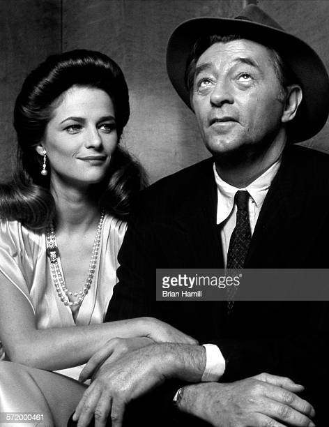 Portrait of English actress Charlotte Rampling and American actor Robert Mitchum on the set of the film 'Farewell My Lovely' 1975
