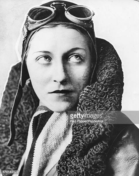 Portrait of English aviator Amy Johnson wearing her flight jacket cap and goggles circa 1935