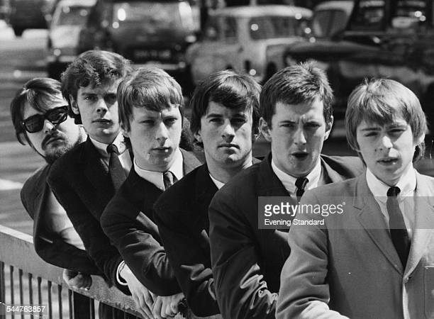 Portrait of English band 'The Yardbirds' leaning on a railing; Manager Giorgio Gomelsky, Paul Samwell-Smith, Chris Dreja, Jim McCarty, Eric Clapton...