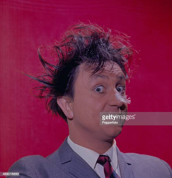 Portrait of English comedian Ken Dodd as he appears on the television series 'Doddy's Music Box' in 1966