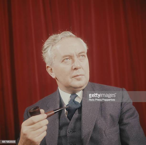 Portrait of English Labour Party politician and Prime Minister of the United Kingdom Harold Wilson posed holding a pipe circa 1965