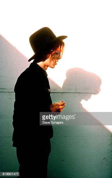 Portrait of English musician and actor David Bowie as he stands in front of a wall during a break in the filming 'The Man Who Fell to Earth' , New...