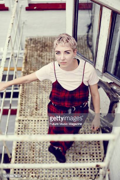 Portrait of English musician and producer Laura Bettinson better known by her stage name FEMME photographed at her home studio in London on September...