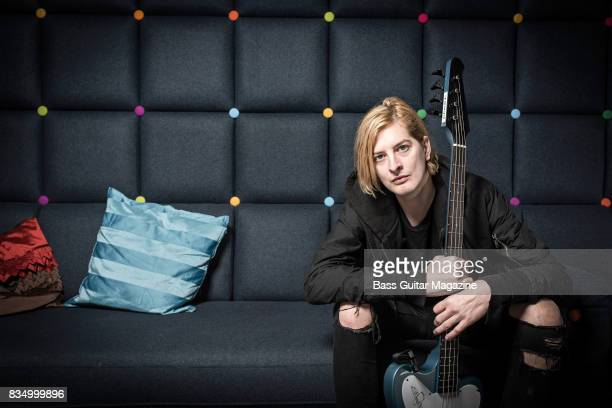 Portrait of English musician Matt Kean bassist with heavy metal group Bring Me The Horizon photographed backstage before a live performance at the O2...
