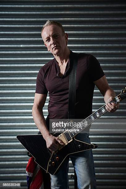 Portrait of English musician Phil Collen guitarist with hard rock group Def Leppard photographed backstage before a live performance at the...