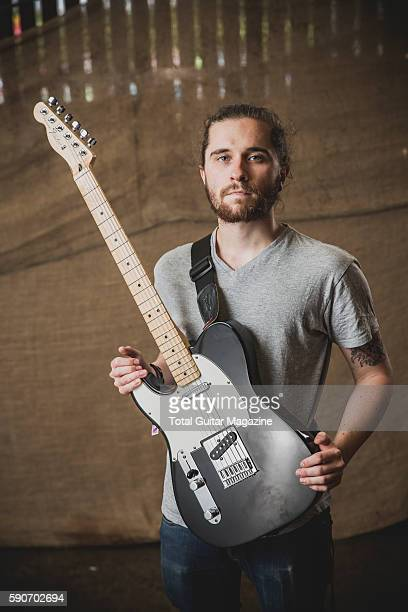 Portrait of English musician Sam Beattie guitarist with progressive rock group Eschar photographed backstage at ArcTanGent Festival in Somerset on...