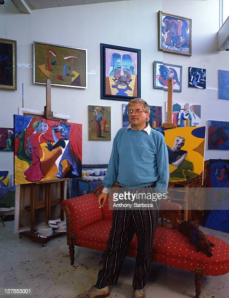 Portrait of English painter David Hockney dressed in a light blue sweatshirt and striped trousers Los Angeles California 1980s