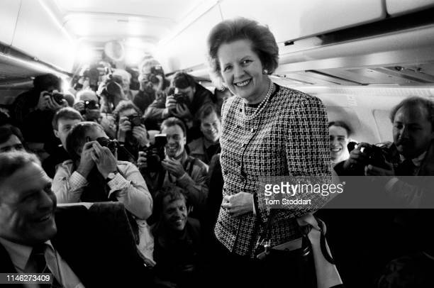 Portrait of English politician UK Prime Minister Margaret Thatcher poses on a airplane in front of photographers during an election campaign May 1985