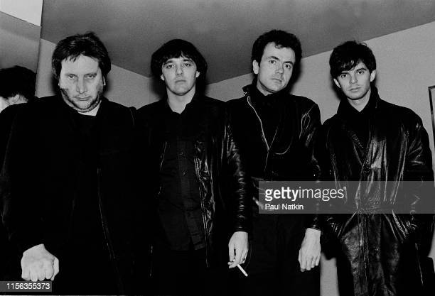 Portrait of English Rock group the Stranglers as they pose backstage at the Park West Chicago Illinois April 19 1983 Pictured are from left Jet Black...