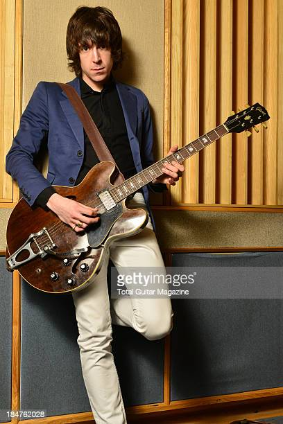 Portrait of English rock musician Miles Kane former frontman with The Rascals and The Last Shadow Puppets photographed with his Gibson ES335 guitar...