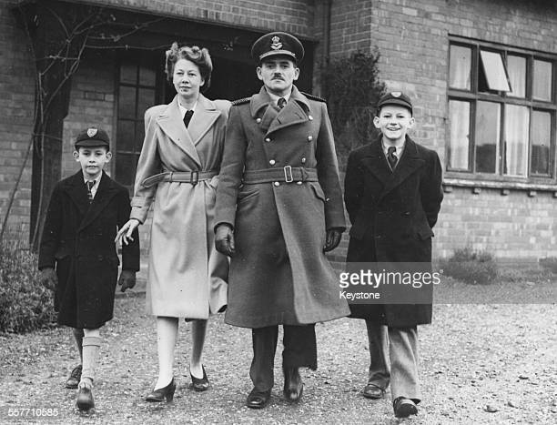 Portrait of English Royal Air Force engineer Sir Frank Whittle inventor of the turbojet engine outside his home with his wife and sons David and Ian...