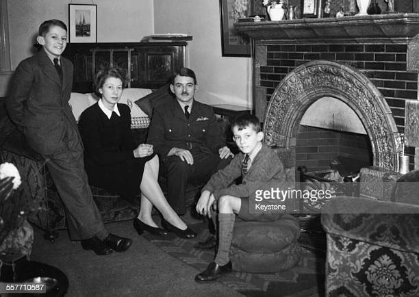 Portrait of English Royal Air Force engineer Sir Frank Whittle inventor of the turbojet engine at his home with his wife and sons David and Ian Rugby...