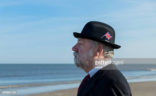 portrait of Englishman standing on the beach, overlooking the sea