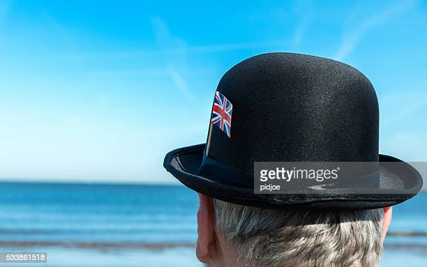 portrait of englishman standing on the beach, overlooking the sea - brexit stock pictures, royalty-free photos & images