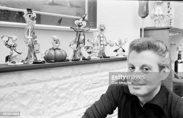 Portrait of entertainer and drag queen Danny La Rue in his home March 27th 1964