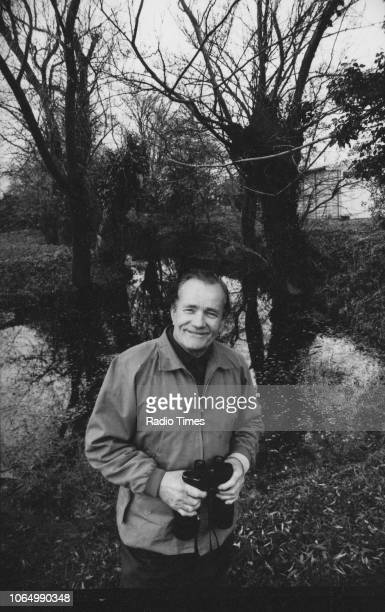 Portrait of entertainer and ornithologist Percy Edwards holding a pair of binoculars while bird watching 1972