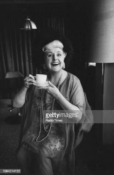 Portrait of entertainer Tessie O'Shea drinking a cup of tea circa 1970