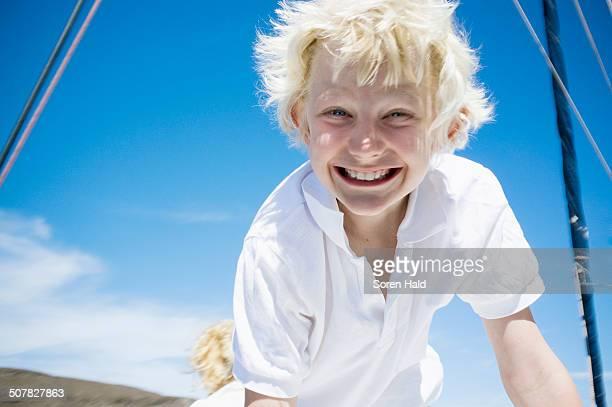 Portrait of enthusiastic boy on catamaran near Fuerteventura, Spain