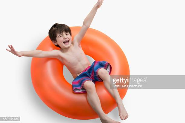 Portrait of enthusiastic Caucasian boy in inflatable ring