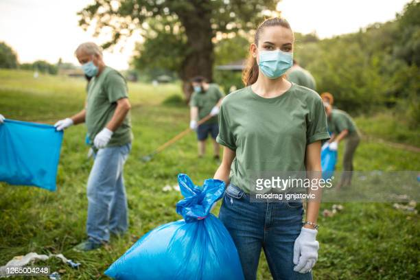 portrait of environmental volunteer with protective face mask - volunteer stock pictures, royalty-free photos & images