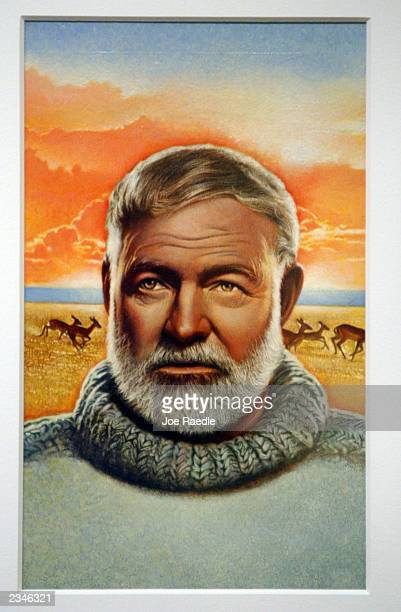 A portrait of Ernest Hemingway hangs on the wall during the opening of the Art of the Stamp exhibition at the Smithsonian National Postal Museum July...