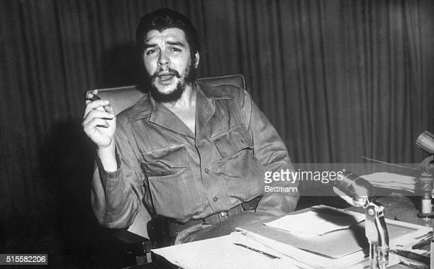 1960 Portrait of Ernesto Che Guevara Cuban revolutionary leader sitting at a desk